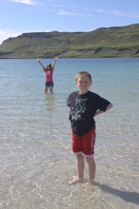Kids enjoy the warm water of the Western Highlands